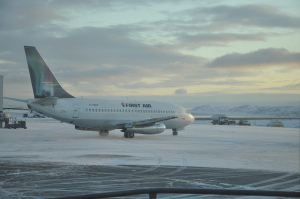 A plane waits on the tarmac of Iqaluit's airport Nov. 22. After flying all the way to Igloolik, my plane turned around headed back for Iqaluit because groundstaff woudln't have been able to de-ice the plane for its next trip, the pilot said.